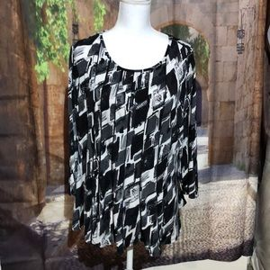 Stylish black and white top with swing